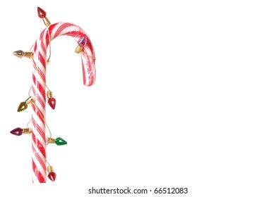 A Single Candy Cane Wrapped in Tiny Christmas Lights with Copy Space