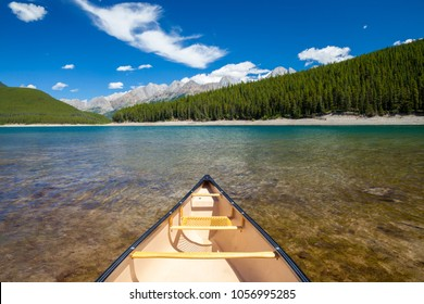 A single canoe on a mountain lake in the Canadian Rocky Mountains