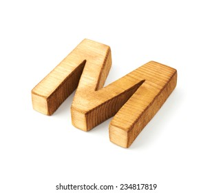 Single capital block wooden letter M isolated over the white background