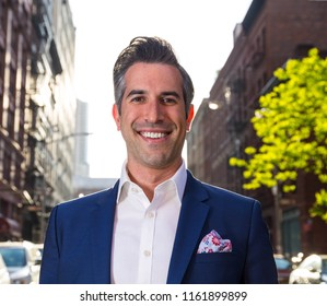 Single Caucasian Business Man Enthusiastically Poses For Picture