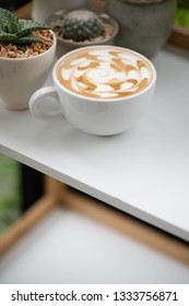 single coffee cup on table.Coffee is trendy beverage in the morning.