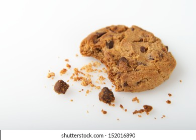 Single Cookie with a Bite and Crumbs Isolated on a White Background