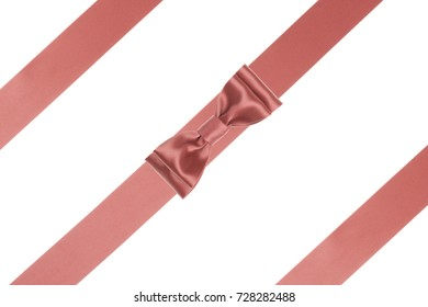 Single coral ribbon bow with parallel silk ribbon isolated on white background