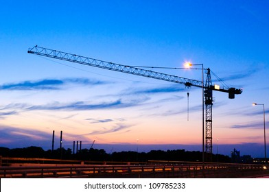 Single crane at night on construction site