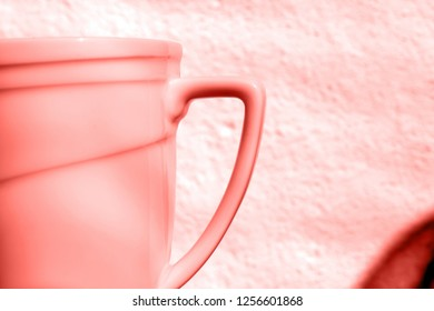 Single cup with asymmetry design in trendy color of living coral