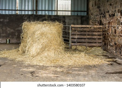 Single cylindrical small hay bale inside barn