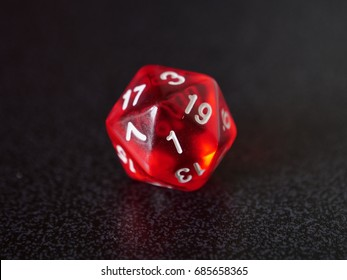 A single d20 dice showing a 1, which is a significant number in tabletop gaming