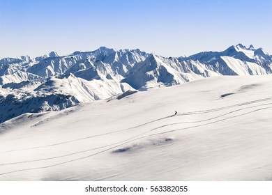 Single Downhill Skier in Front of Beautiful Mountain Panorama