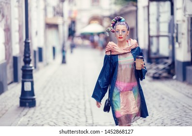 Single edgy girl with extravagant look on streets. Crazy appearance on boulevard. Avant-garde fashion concept