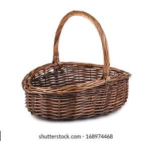 Single empty wicker basket isolated on white background