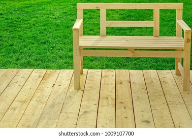 Single Empty Wooden Bench On The Backyard Wooden Patio, Close Up