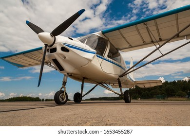 Single engine microlight aircraft on parking position on an airport