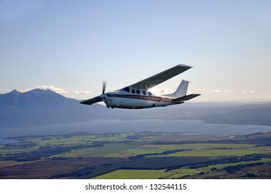 Single engined light aircraft flying over Westland, New Zealand