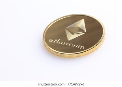 Single Ethereum coin on a white surface.