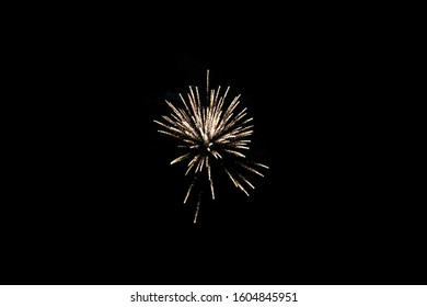single explosion of one firework in the distance