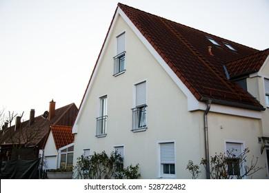 Single family house in Munich, blue sky, white facade