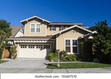 Single family house  with two levels and a driveway.