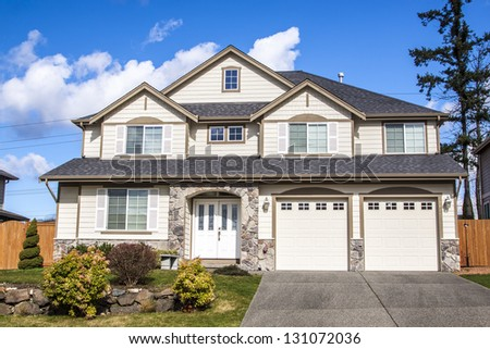 Single family house with two levels and blue sky on background