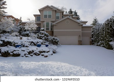Single family luxury home in North America suburban neighborhood on a snow covered day in winter