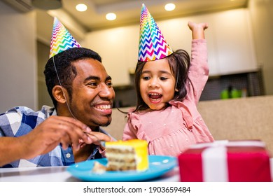 single father and his little daughter celebration birth day in kitchen