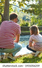 Single father and little daughter enjoying in the park.