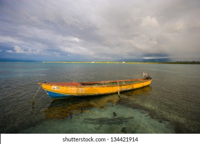 Single Fishing Boat in the Caribbean Sea with an Blue Sky