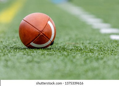 A single football on green grass