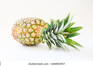 Single freshness pineapple with green leaves on white background isolated, tropical fruit, juicy, sweet and sour make your summer cool.