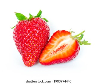 Single fruit and a half cut strawberry isolated on white background with copy space and clipping path. Fresh harvested homegrown strawberry fruit.