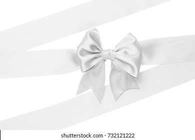 Single gift bow, white satin, with ribbons isolated on white