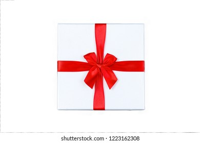 Single gift box with ribbon and red bow on white