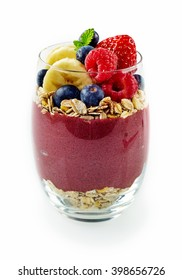 Single glass full of mixed acai, banana, blueberry and rolled oats over isolated white background