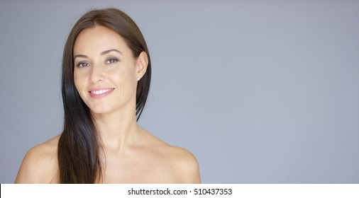 Single gorgeous woman over gray background