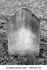 single grave stone standing in a church grave yard