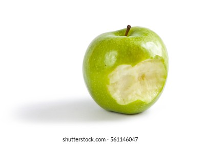 A single green apple with a bite taken.