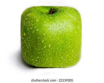 A single green apple in the shape of a square / cube isolated on white with water droplets on it. Fresh Fruit.