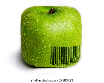 A single green apple in the shape of a square isolated on white with water droplets on it. A generic (not real) bar code printed on the apple.