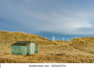 Single green hut. South Gare. Located on the north east coast of England.