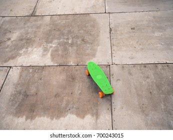Single Green Penny Board On Wooden Stock Photo Edit Now 700243012