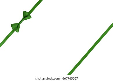 Single green satin bow on ribbon for decoration on white background