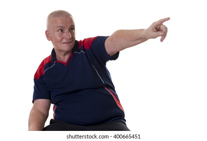 Single grinning balding man in blue and red short sleeve shirt pointing finger at something over white background