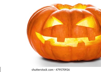 Single Halloween pumpkin. Scary Jack O'Lantern face isolated on a white background.