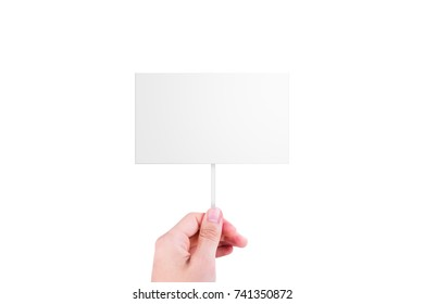 Single hand holding blank, white cardboard with copy space for design, isolated on white background.
