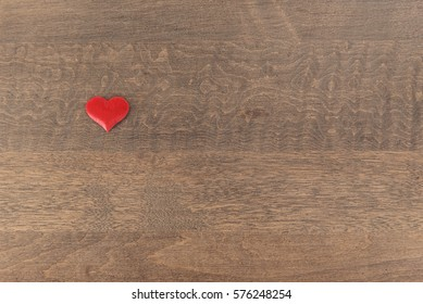 Single heart isolated on a wood background