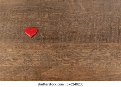 Single heart on a wood background