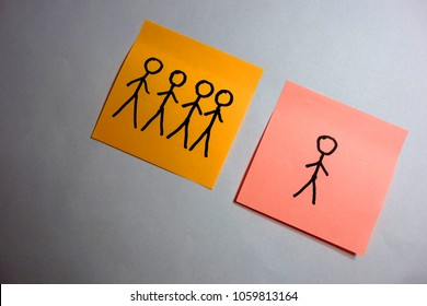 Single human figure behind a group, abstract loneliness concept