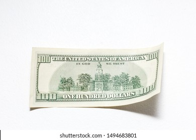 Single Hundred Dollar Bill Curled on White