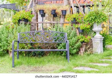single iron bench in the garden