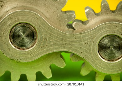 Single joint machine element consisting of two central cogwheel parts spinning together as system of connected properties, symbolizing thinking concept and mechanical approach to kinetic problems