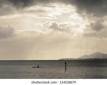 a single kayaker in the waters of Hawaii Kai on the island of Oahu, Hawaii